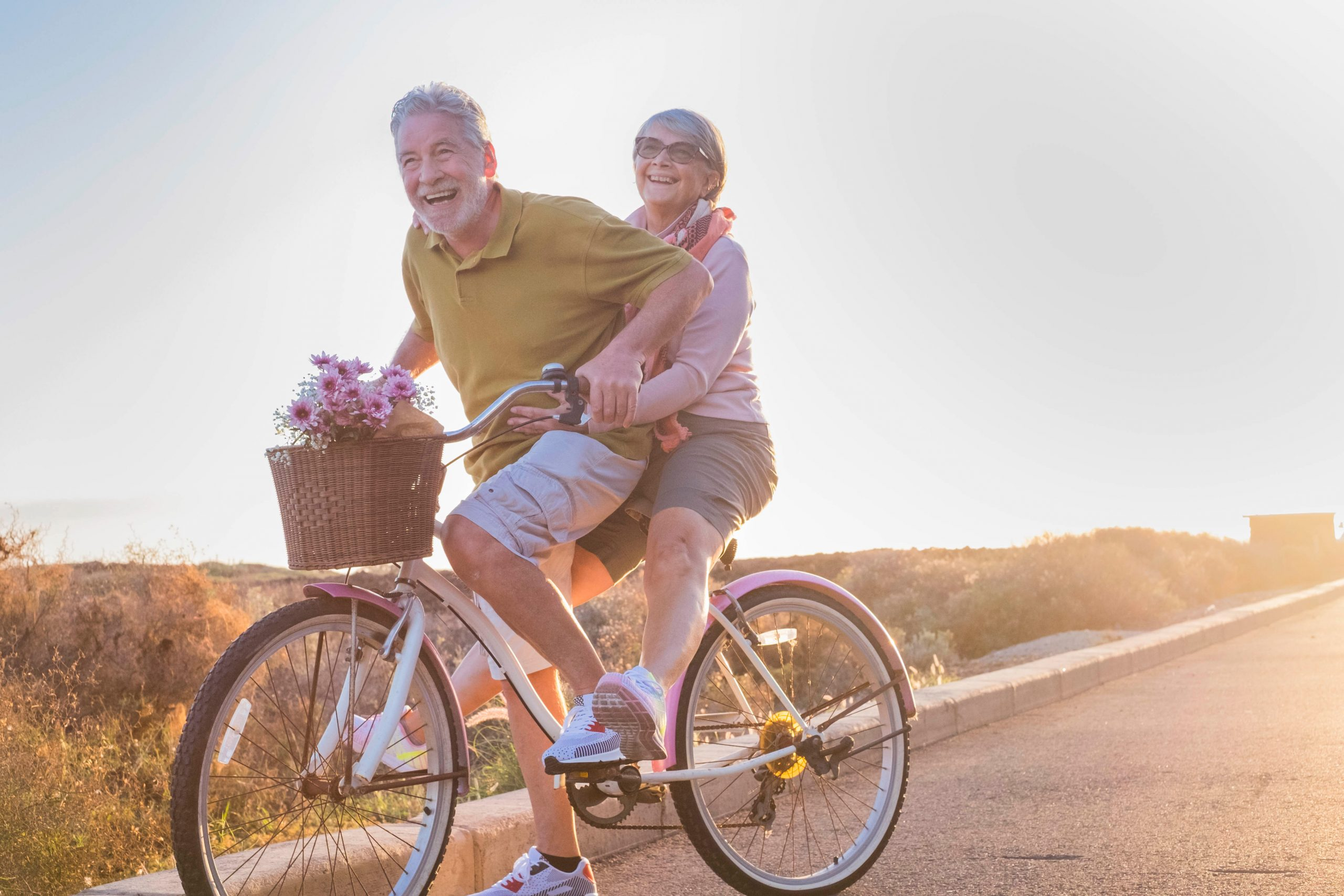 happy-elder-couple-on-a-bike-for-two-people